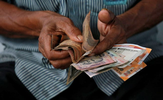 Rupee Ends Lower At 69.80 Against Dollar