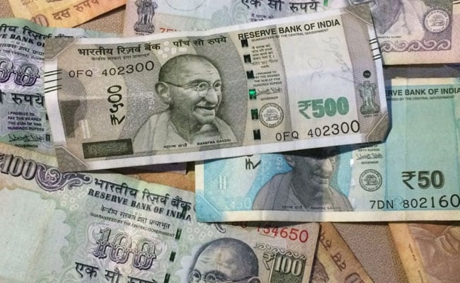 Rupee Ends Lower At 69.58 Against Dollar